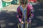 Imogen making a willow hoop for the sweetpeas