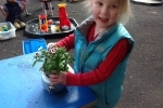 Poppy planting a carnation in the teapot