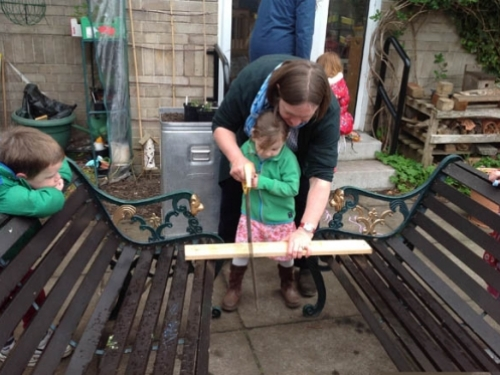 Arianwen cutting bamboo with the big saw2