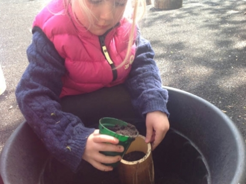 Grace filling up her bamboo pot