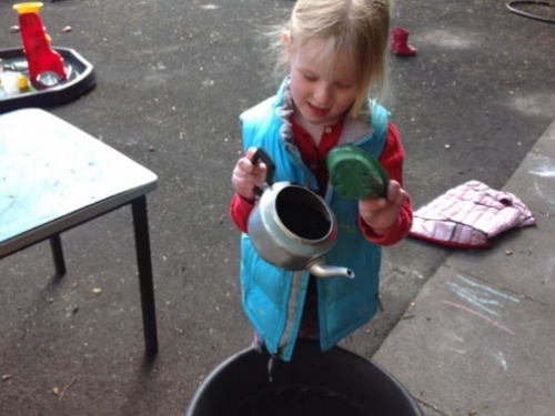 poppy popping compost in a teapot ready for planting